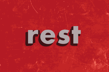 at rest: rest vector word on red concrete wall