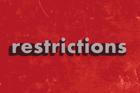 restrictions: restrictions vector word on red concrete wall
