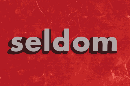 seldom: seldom vector word on red concrete wall
