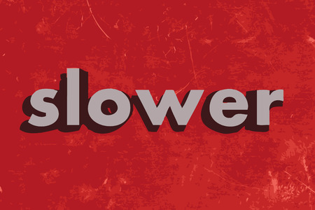 slower: slower vector word on red concrete wall