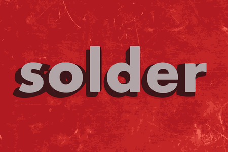 solder: solder vector word on red concrete wall