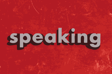 talking dictionary: speaking vector word on red concrete wall