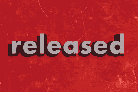 released: released vector word on red concrete wall