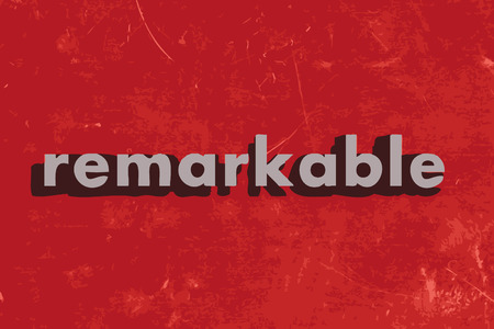 remarkable: remarkable vector word on red concrete wall