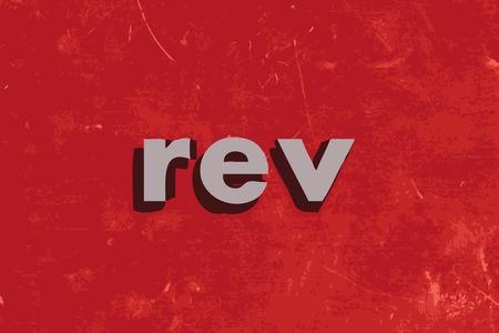 rev vector word on red concrete wall