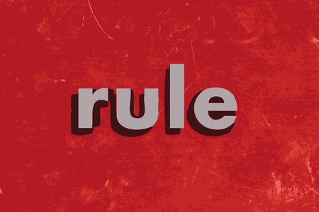 rule: rule vector word on red concrete wall