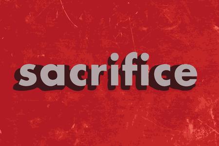 sacrificio: sacrificar palabra del vector en rojo muro de hormig�n