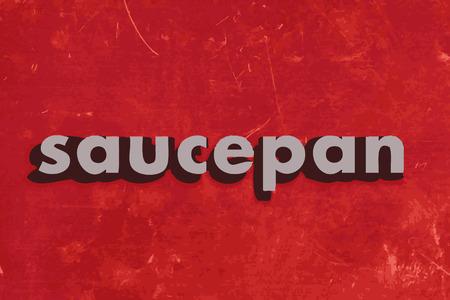 saucepan: saucepan vector word on red concrete wall