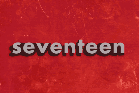 seventeen: seventeen vector word on red concrete wall