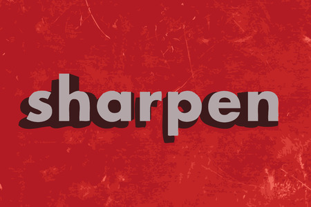 sharpen: sharpen vector word on red concrete wall