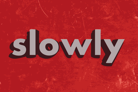 slowly: slowly vector word on red concrete wall
