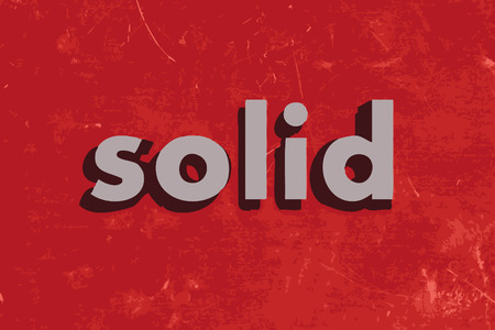 solid: solid vector word on red concrete wall