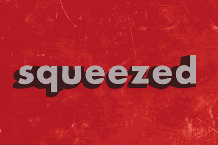 squeezed: squeezed vector word on red concrete wall