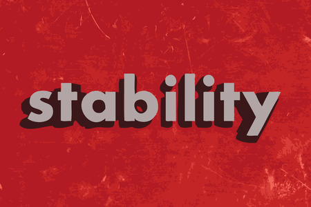 stability: stability vector word on red concrete wall