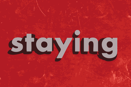 staying: staying vector word on red concrete wall