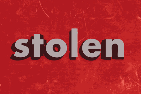 stolen: stolen vector word on red concrete wall