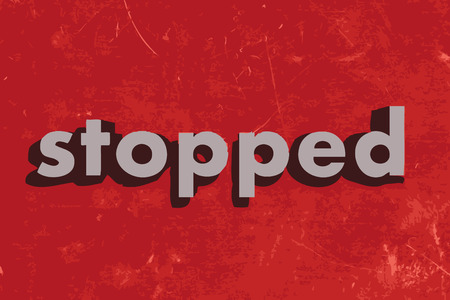 stopped: stopped vector word on red concrete wall