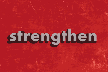 strengthen: strengthen vector word on red concrete wall