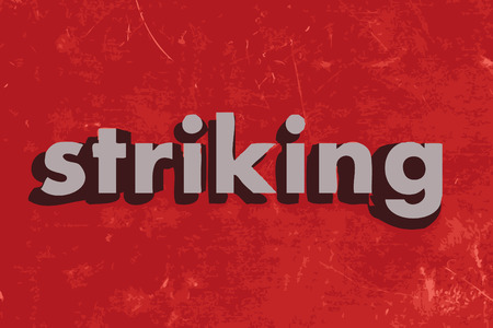 striking: striking vector word on red concrete wall