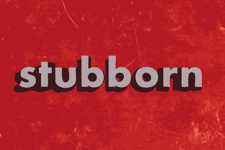 stubborn: stubborn vector word on red concrete wall
