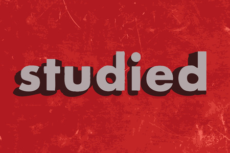 studied: studied vector word on red concrete wall