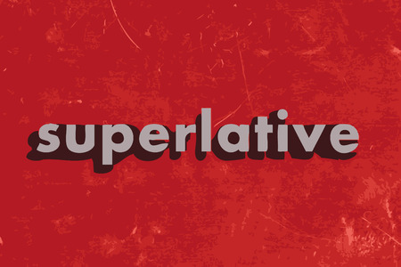 superlative: superlative vector word on red concrete wall