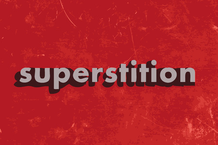 superstition: superstition vector word on red concrete wall