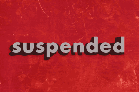 suspended: suspended vector word on red concrete wall