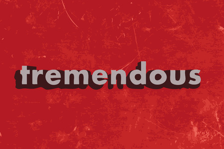 tremendous: tremendous vector word on red concrete wall