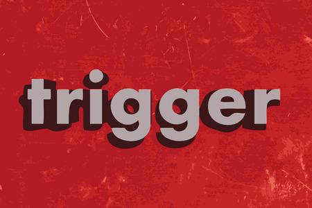 trigger: palabra gatillo del vector en rojo muro de hormig�n