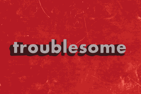 troublesome: troublesome vector word on red concrete wall Illustration