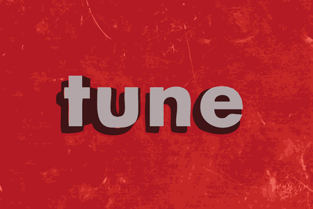 tune: tune vector word on red concrete wall