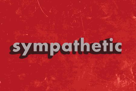 sympathetic: sympathetic vector word on red concrete wall