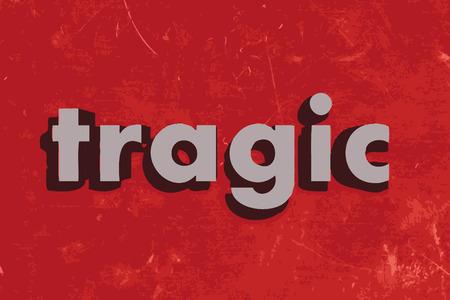 tragic: tragic vector word on red concrete wall