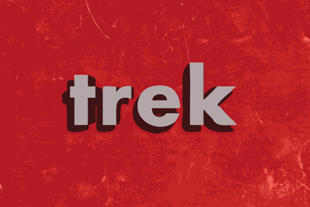 trek vector word on red concrete wall