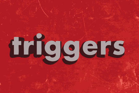 triggers: triggers vector word on red concrete wall