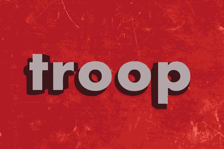 troop: troop vector word on red concrete wall