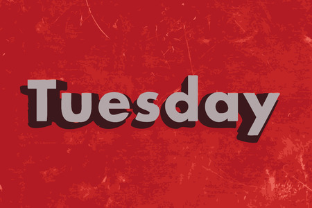 Tuesday vector word on red concrete wall