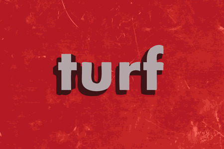 turf: turf vector word on red concrete wall