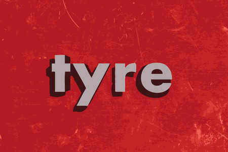 vector tyre: tyre vector word on red concrete wall