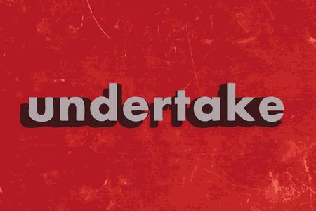 undertake: undertake vector word on red concrete wall
