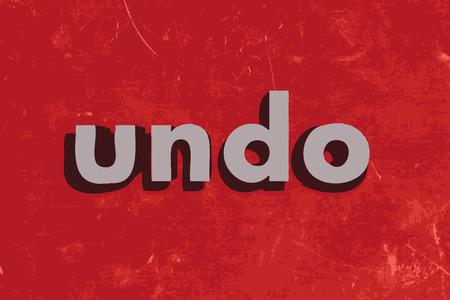 undo: undo vector word on red concrete wall