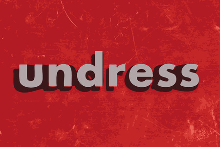 undress: undress vector word on red concrete wall