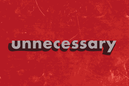 unnecessary: unnecessary vector word on red concrete wall