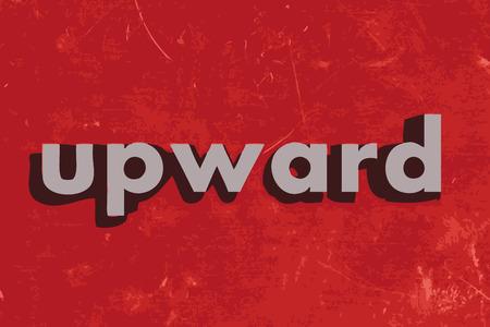 upward: upward vector word on red concrete wall