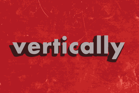 vertically: vertically vector word on red concrete wall
