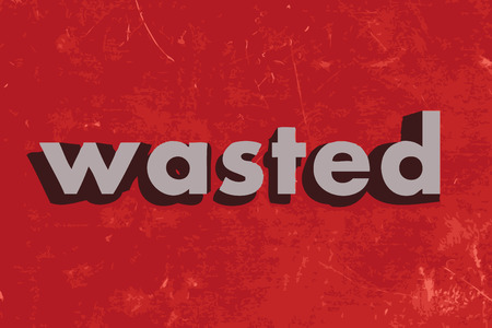 wasted: wasted vector word on red concrete wall