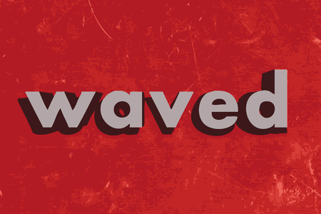 waved: waved vector word on red concrete wall