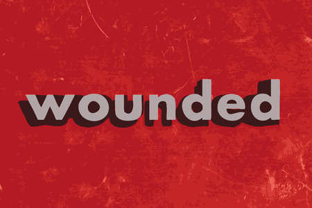 wounded: wounded vector word on red concrete wall