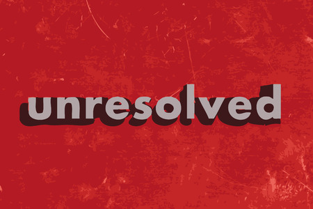 unresolved: unresolved vector word on red concrete wall